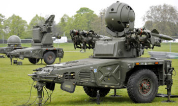 British Army Gunners from 16 Regiment, Royal Artillery, set up a Rapier FSC Ground Based Air Defence (GBAD) system at Blackheath, London on 2 May 12.   The Rapier is one of six GBAD systems being placed around London as part of Exercise Olympic Guardian. This major military and civilian exercise is taking place to help make the London 2012 Olympic Games as safe and secure as possible. It will see a wide range of capabilities rehearsed in a deliberate and orchestrated manner over a nine-day period.   Rapier, and the smaller Starstreak system, may be deployed for the Games as part of the Air Security Plan, which aims to secure the Olympics from an airborne attack. It is just one aspect of a multi-layered plan that includes RAF Typhoon interceptor aircraft, military helicopters carrying RAF Regiment snipers, and a range of radars and sensors based around the UK. While the missiles may be the most noticeable aspect of Rapier and Starstreak, their primary role will be to use their detection capabilities to provide an additional ability to identify unauthorised aircraft in the restricted airspace around London.