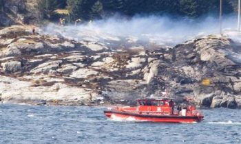 Rescuers work at a site where a helicopter crashed, west of the Norwegian city of Bergen, in April. Picture: NTB SCANPIX/BERGENS TIDENDE/VIA REUTERS