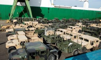 Vehicles stage at the Riga Port A fleet of military vehicles wait in a staging lot after being offloaded from ship in preparation of Exercise Saber Strike 16 in Riga, Latvia, June 4, 2016. Exercise Saber Strike is an annual combined-joint exercise in the Baltic region. The combined training prepares allies and partners to rapidly amass during regional crises and meet their own security needs by improving the security of borders and countering threats.