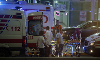 Turkish rescue services gather outside Istanbul's Ataturk airport, Tuesday, June 28, 2016. Two explosions have rocked Istanbul's Ataturk airport, killing several people and wounding others, Turkey's justice minister and another official said Tuesday. A Turkish official says two attackers have blown themselves up at the airport after police fired at them. The official said the attackers detonated the explosives at the entrance of the international terminal before entering the x-ray security check. (AP Photo/Emrah Gurel)