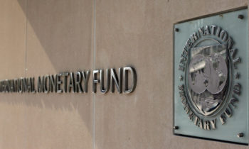 (FILES): This April 5, 2007 file photo shows the International Monetary Fund logo at IMF headquarters on Pennsylvania Avenue in Washington, DC. The IMF announced November 2, 2009 the sale of 200 tonnes of gold to India's central bank, nearly half the amount targeted for sale over the coming years to shore up IMF finances.  The total sales proceeds are equivalent to 6.7 billion dollars, the IMF said.   AFP PHOTO / Files / TIM SLOAN (Photo credit should read TIM SLOAN/AFP/Getty Images)